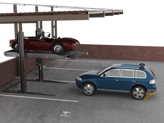 два авто возле стоечного парковочного подъемника
